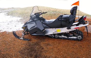 Illustrated black snowmobile