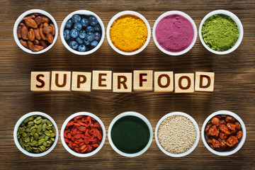 Superfoods on wooden table