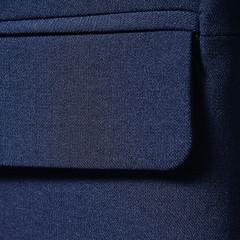 Navy blue cotton textile for background closeup of jacket pocket