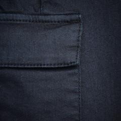 Navy blue denim textile for background closeup of pocket