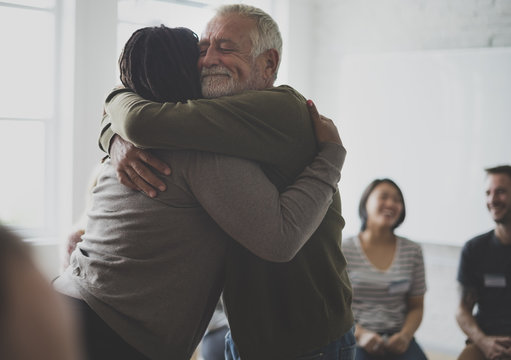 Old guy consoling a woman with a hug