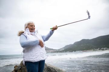 Senior woman taking a selfie from selfie stick
