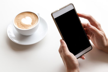 Taking photograph of coffee by smartphone