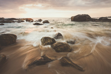Beautiful sunset at the west coast of Sri Lanka. Great Atmosphere with long exposure and water motion blur.