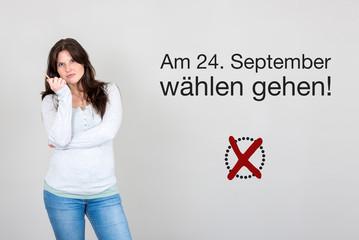 Frau mit Aufruf zum wählen gehen für Bundestagswahl Deutschlan
