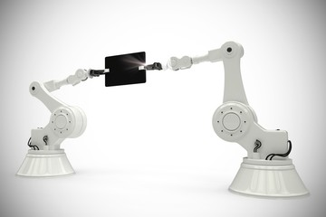 Composite image of composite image of robots holding digital tab