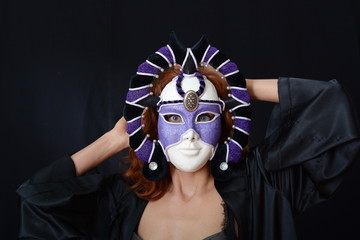 girl with red hair in an old Venetian mask