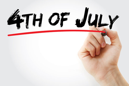 Hand writing 4th of July with marker, holiday concept background