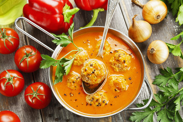 Meatball soup with  paprika