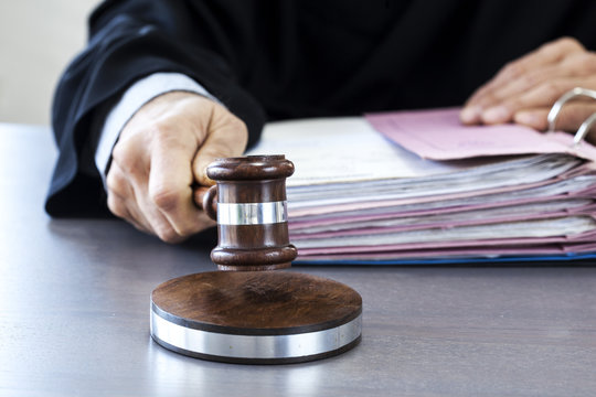 Judge with gavel on table