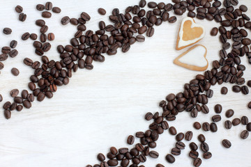 date with gusto/ couple cookies in the shape of heart in coffee beans scattered on the table top view
