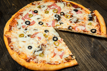 Top view of Italian rustic PIZZA on wooden table background
