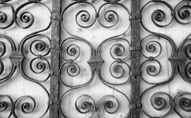 Ornate old fence - close up, black and white.