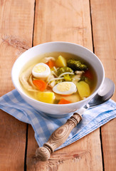 Chicken noodle soup with broccoli and quail eggs
