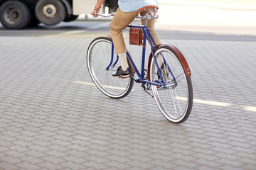 hipster man riding fixed gear bike