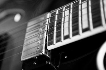 Strings electric guitar closeup in black and white