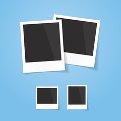Realistic looking polaroid photo frames, isolated on blue background, vector illustration. Easy to use for your design with transparent shadows.
