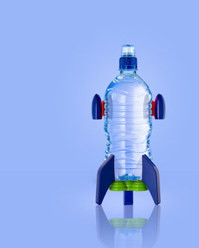 Water bottle in the form of a rocket on blue background