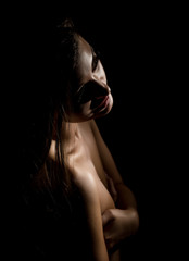 silhouette of nude beautiful asian woman on black background