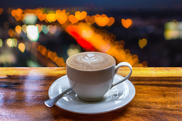 Coffee on table and bokeh heart shape