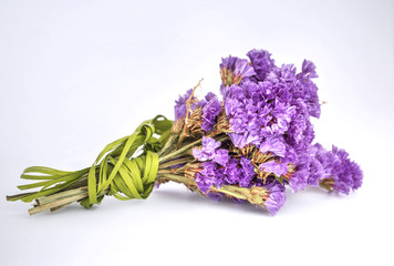 Little bouquet of dry violet flowers, decorated with green rib