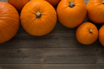 Overhead of Pumpkins on Wooden Surface with Copy Space