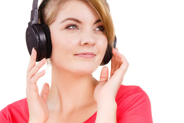 Woman in big headphones listening music isolated