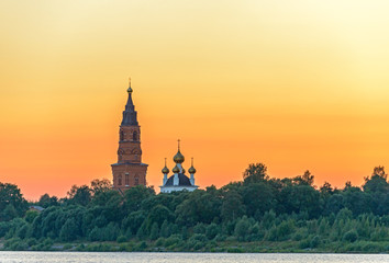 Old orthodox cathedral over sunset sky