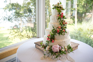 Decorated wedding cake on wooden cake stand