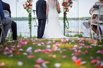 Wedding service with flower petals on grass