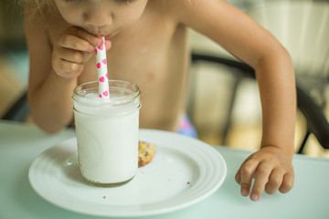 Bare chested child drinking milk