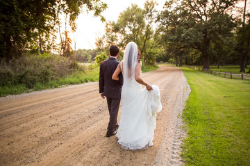 Married couple walking on path, back to camera