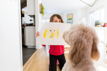 Child showing dog portrait
