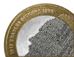 Charles Dickens UK two pound coin close up isolated on white