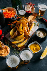 Fries with sauces and beers