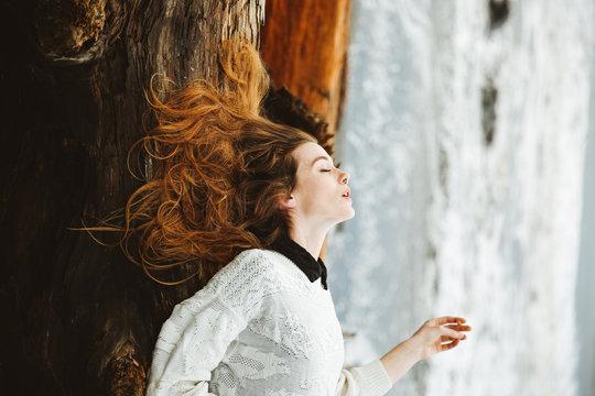 Woman lying on a log on a beach