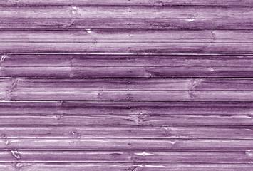 magenta toned wooden wall texture.