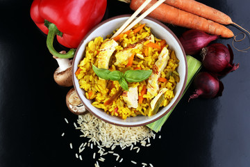Homemade Chinese fried rice with vegetables, chicken and fried e