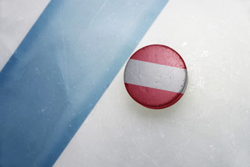 old hockey puck with the national flag of austria