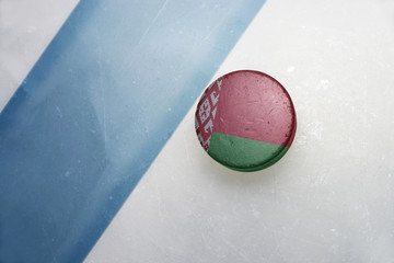 old hockey puck with the national flag of belarus