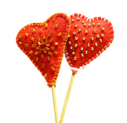 Decorative hand made two hearts isolated on white background. Sewed from a felt and decorated with beads. Beautiful congratulation card background for St. Valentine`s day. Copyspace.