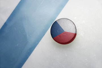 old hockey puck with the national flag of czech republic