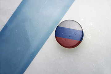 old hockey puck with the national flag of russia
