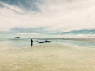 View of Virgin Island in Panglao, Philippiines with a men and a small boat