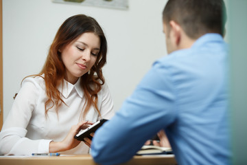 Employees discussing subject with tablet