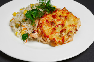 Baked meat with mushrooms and cheese with