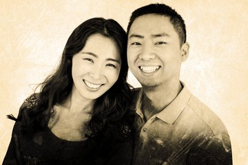 Composite image of portrait of couple smiling