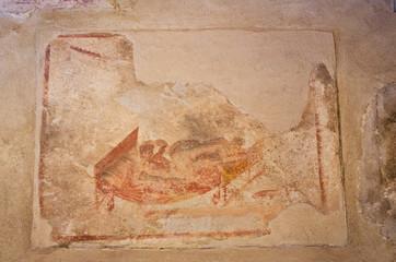 Ancient Roman fresco in Pompeii ruins, Italy.