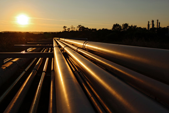 steel pipeline system during sunset