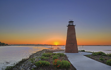 Dawn view over Lake Toho (Lake Tohopekaliga) in Kissimmee Florida including walkway and mini lighthouse.